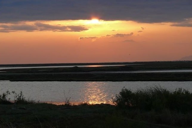 Sunset in the Evros Delta wetland in Greece, from https://www.greece-travel-secrets.com/Evros-Delta.html
