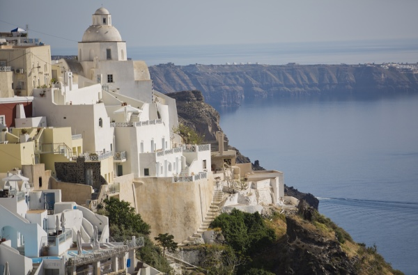 The Greek island of Santorini, from https://www.greece-travel-secrets.com/Greek-food-and-drink-cruises.html