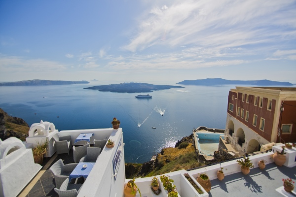 The Greek island of Santorini, from https://www.greece-travel-secrets.com/Greek-food-and-drink-cruises.html