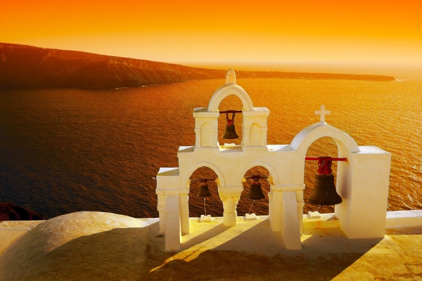 Sunset at Oia on Santorini in the Cyclades Islands of Greece: https://www.greece-travel-secrets.com/Santorini.html
