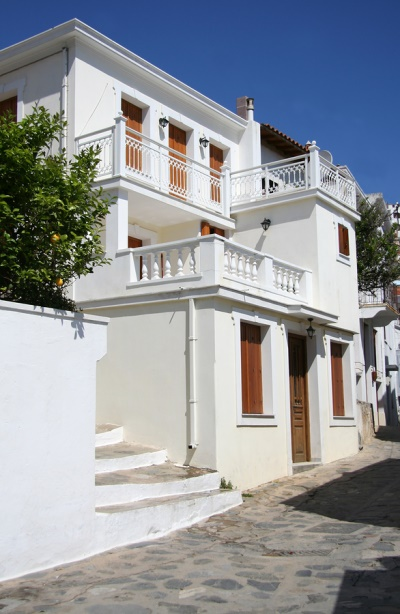 Skopelos in the Sporades Islands: https://www.greece-travel-secrets.com/Skopelos.html
