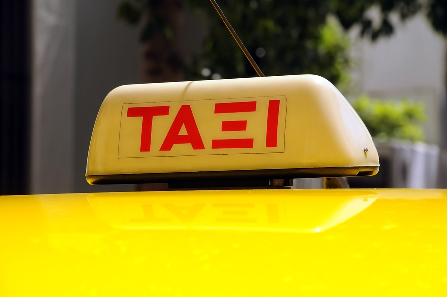 Greek taxi sign