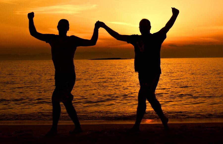 Greeks dancing at sunset