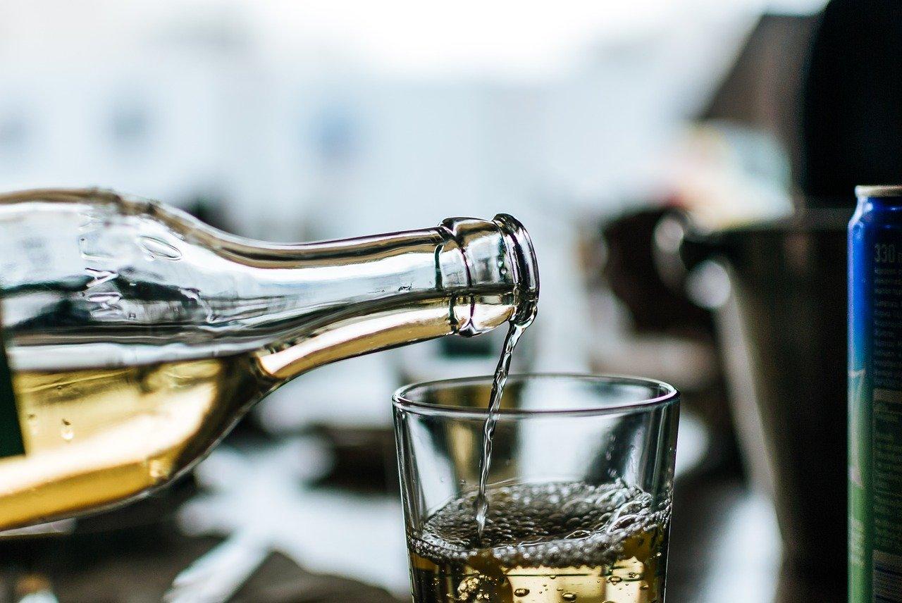 Pouring a glass of retsina