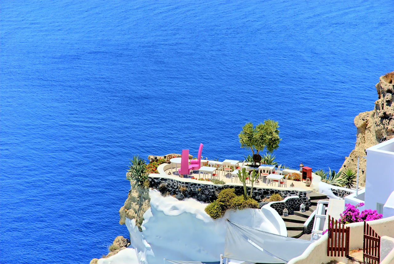 Tables with a view on Santorini in the Cyclades Islands of Greece