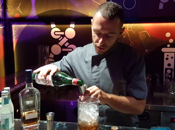 Bartender making a cocktail in Athens, Greece