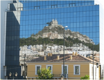 The old reflected in the new in Athens, photo (c) Donna Dailey for Greece Travel Secrets