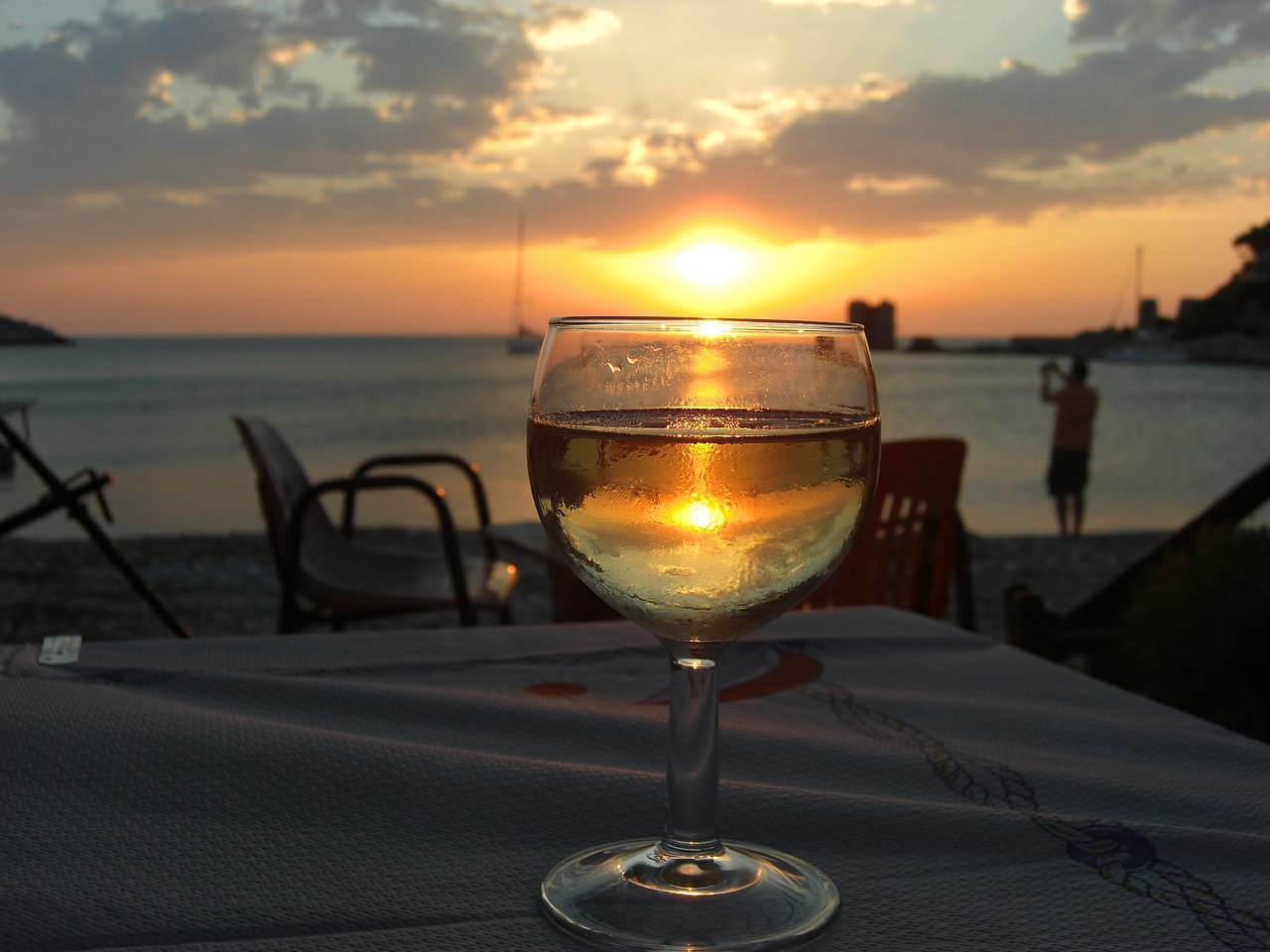 Glass of wine at sunset on Evia