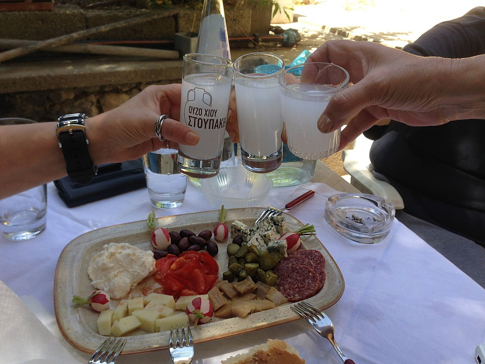 Bottle and glasses of ouzo, the Greek alcoholic aperitif.